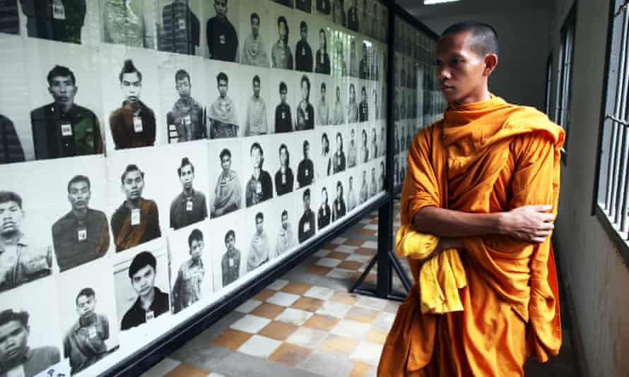 A Cambodian looks at photos of victims on display at the Toul Sleng Genocide museum.