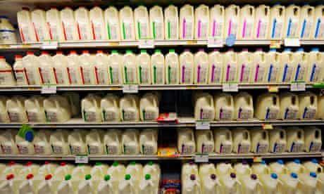 Coloured milk bottle tops on the supermarket shelf.