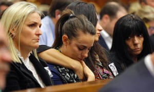 Members of the gallery react as mobile phone messages sent by Oscar Pistorius are read out