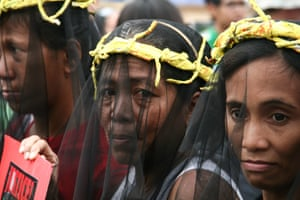 In front of the church in Quiapo, Philippines, mothers and daughters of typhoon Haiyan victims wear black veils with yellow thorns symbolizing the suffering that they are still facing due to the alleged lack of financial and reconstruction assistance form the Aquino administration.