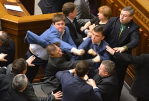 Communist lawmakers scuffle with right-wing Svoboda (Freedom) Party lawmakers during a parliament session of Verkhovna Rada, the Ukrainian parliament, in Kiev.
