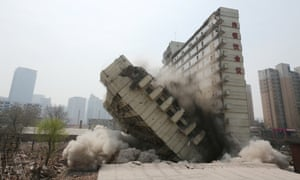 Auspicious Clouds: One half of the Xiangyun Building falls in Shenyang city. The Xiangyun Building, meaning the Auspicious Cloud Building, is demolished to make way for the construction of a commercial property project.