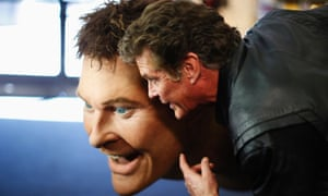 David Hasselhoff poses with a replica of himself built for the The SpongeBob SquarePants Movie, during an auction in Beverly Hills, California.