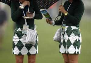 Golf fans in matching outfits at Augusta National Golf Club, Georgia, ahead of the start of the Masters Golf Tournament.
