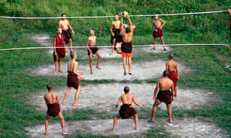 Monks play volleyball at Rabdey Dratsang in the southeastern district of Samdrup Jongkhar in Bhutan