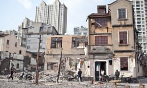 Houses are demolished in Xinping Lane.