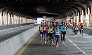 Men's elite runners contend with potholes during the New York City Marathon.