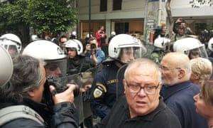 Protestors demand that riot policemen let them through to the ministry of finance in Athens, Greece, during a 24-hour strike today by media workers. Photo: Pacific Press/Barcroft India