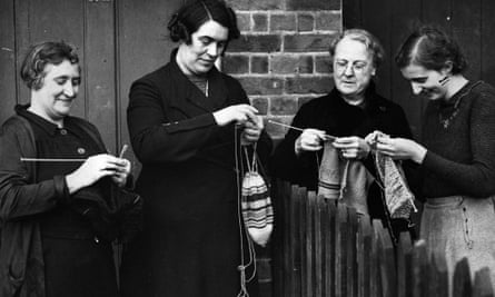 Women knit as they chat over the garden fence in Bayford, Hertfordshire.