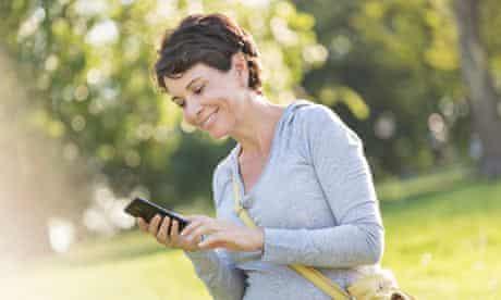 woman text messaging outdoors.