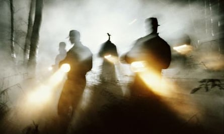 Search party shining   in fog, silhouette