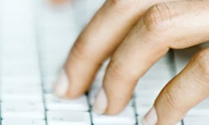 Woman's hands on computer keyboard