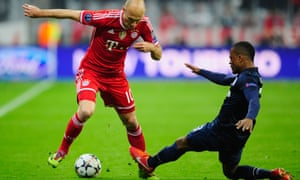 Bayern Munich's Arjen Robben does his best to keep the ball away from Patrice Evra of Manchester United.