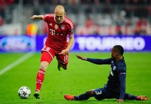 Bayern v United: A sliding Patrice Evra stops the fleet-footed Arjen Robben