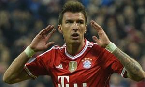 Bayern Munich's Mario Mandzukic celebrates scoring against Manchester United in the Champions League quarter-final.