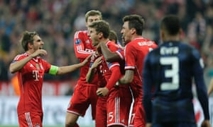 Bayern's Thomas Muller, centre, celebrates with team-mates after scoring his side's second goal against Manchester United.
