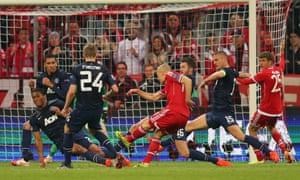 Arjen Robben scores Bayern's fourth goal of the game and all but end Manchester United's hopes of progressing.