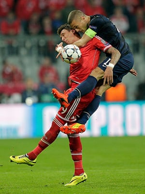 Bayern v United: Nemanja Vidic climbs over Mario Mandzukic