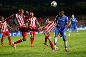 Tom's Chelsea pics: Miranda hacks the ball clear from Eto'o