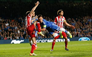 Tom's Chelsea pics: John Terry gets a knee to the head from Juanfran