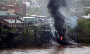 A burning tanker lies in the James river in Lynchburg after the oil train derailment.