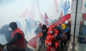 Turkish riot police use water cannons and tear gas  near Taksim square in Istanbul.