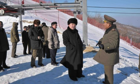 This picture released by KCNA in December 2013 shows North Korean leader Kim Jong-un (C) inspecting the ski resort on Masik Pass.