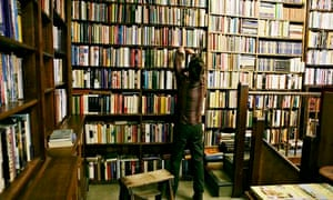 A man looking at books