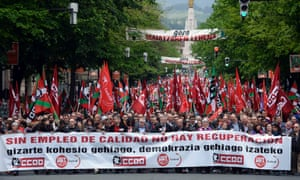 """Union leaders during May Day celebrations in Bilbao The banner in front reads, """"Without Quality Employment, There is no Recovery'"""