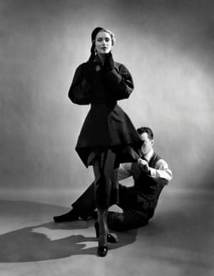 Designer Charles James pinning a suit on a model, 1948.