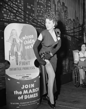 The stripper Gypsy Rose Lee at a March of Dimes benefit lunch in New York, 1945, wearing Charles James.