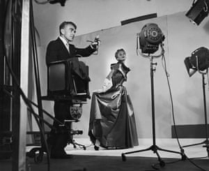 Photographer Horst directing lights and cameras before taking fashion pix of Lisa Fonssagrives, 1949.