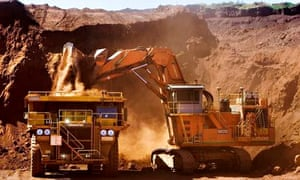 A haul truck is loaded with iron ore at a Rio Tinto mine in the Pilbara region of Western Australia