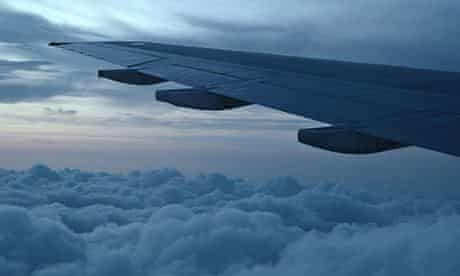 plane wing with clouds