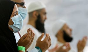 Egyptian Muslims wear masks as a precaution against the Middle East respiratory syndrome