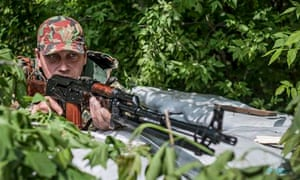 Pro-Russian militants hold their position on a checkpoint in Slavyansk, Ukraine