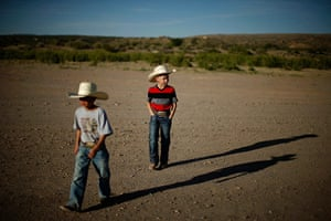 From the agencies: Zaryah Muller and Esteban Edwards walk in Truth or Consequences, New Mexico