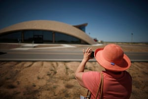 From the agencies: A woman photographs Spaceport Operations Centre in Truth or Consequences