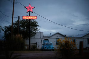 From the agencies: A motel displays a neon vacancy sign in Truth or Consequences, New Mexico