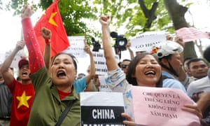 Protesters shout anti-China slogans outside the embassy.