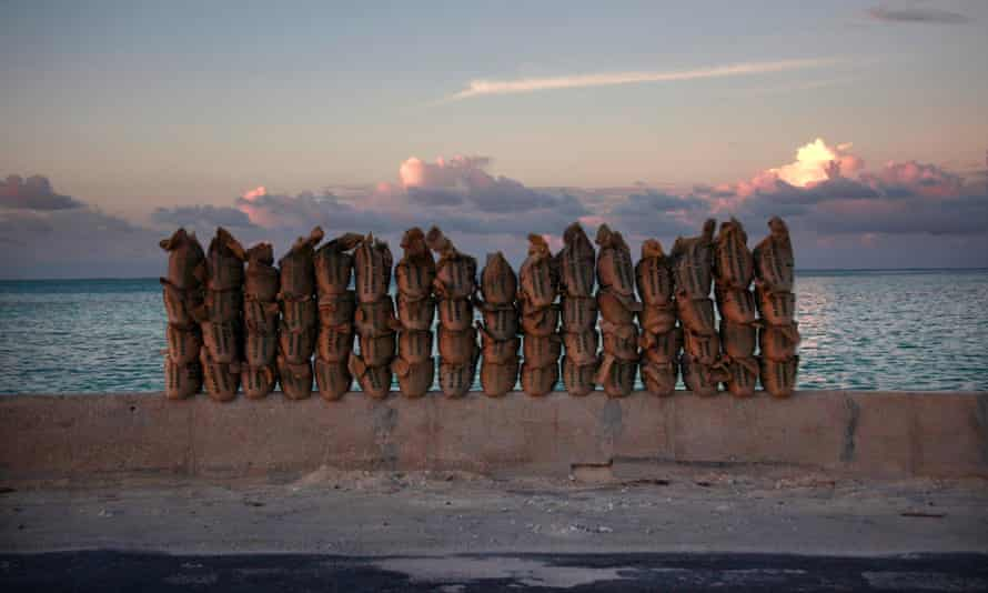 Newly made sandbags sit on a wall on a causeway that connects the town of Bairiki and Betio on South Tarawa in the central Pacific island nation of Kiribati.