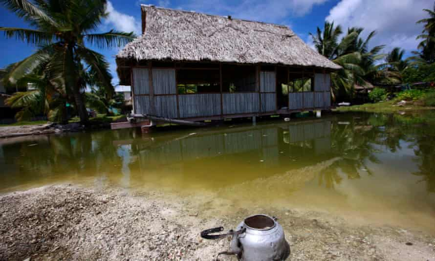 An abandoned house that is affected by seawater during high-tides stands next to a small lagoon near the village of Tangintebu.