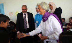 International Monetary Fund managing director Christine Lagarde visits Syrian refugees in a school on May 11, 2014 in Mafraq, north Jordan, near the border with Syria.