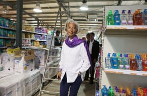 International Monetary Fund managing director Christine Lagarde tours a hypermarket during a visit to the Al Zaatari camp for Syrian refugees on, May 11, 2014 in north Jordan.