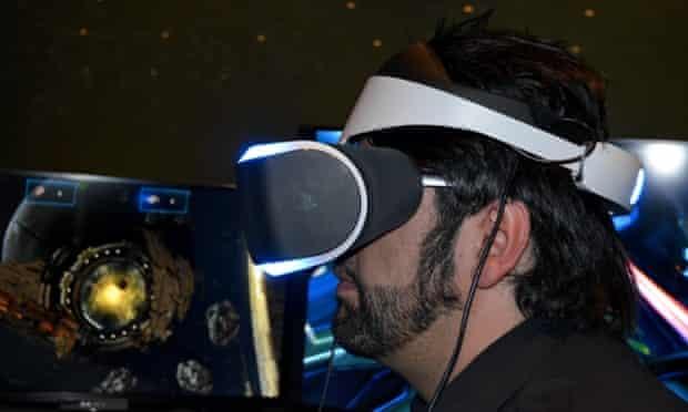 A headset-wearer, bearded, side view