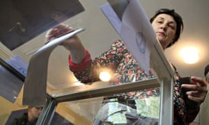 A woman casts her vote at a polling station in Donetsk, Ukraine, in May 2014