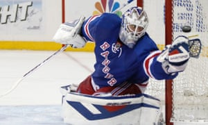 New York Rangers goalie Henrik Lundqvist makes a save in Game 6 of an NHL playoff series against the Pittsburgh Penguins.