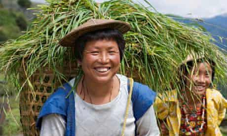 Bhutanese Farmers Carrying Full Baskets