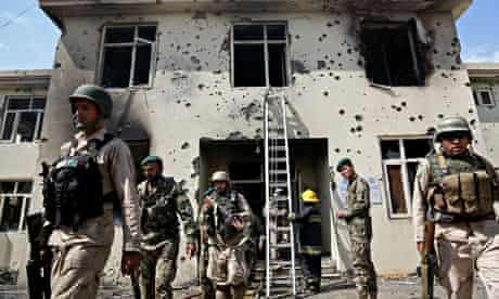 Afghan forces surround a justice ministry building in Jalalabad