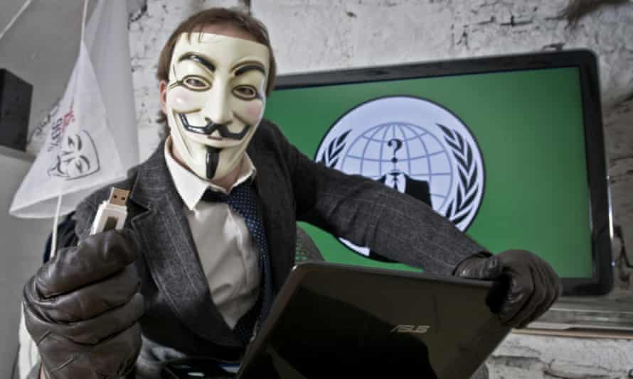 A portrait of an Anonymous activist in his office.